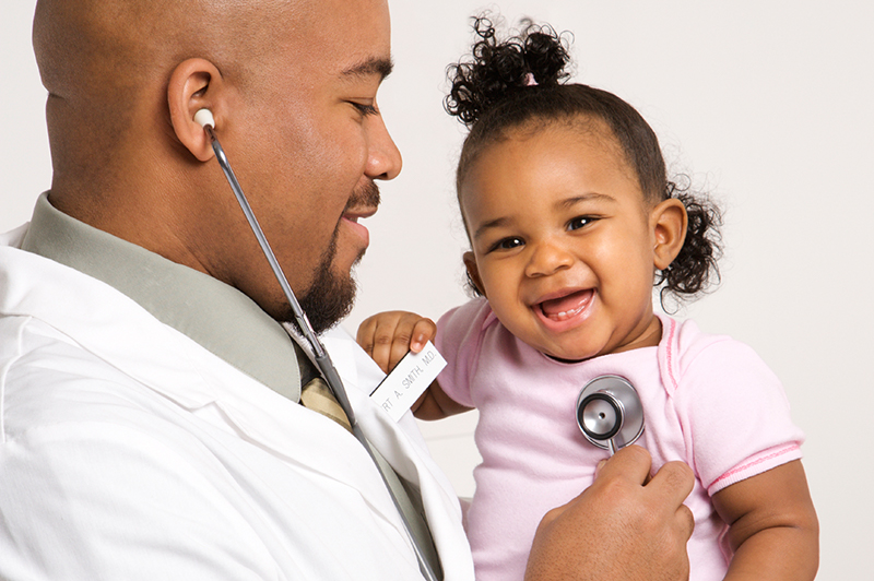 doctor checking child's heartbeat