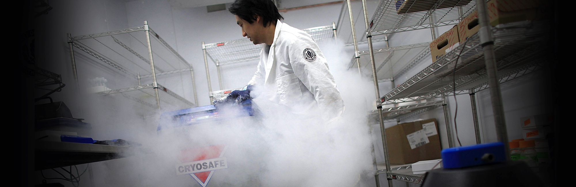 Senior postdoctoral fellow Xiaofang Wang pulls out frozen stem cells in a lab at the University of Connecticut`s (UConn) Stem Cell Institute at the UConn Health Center