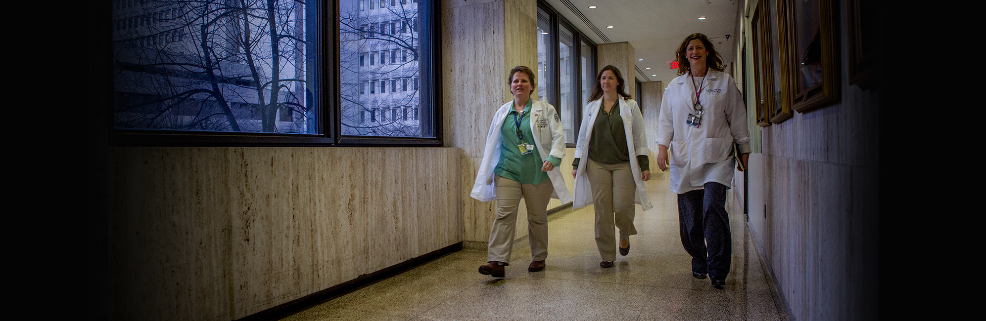 UConn Personel walk through UConn Health John Dempsey hospital hallway