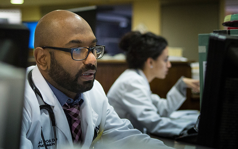 UConn Health medical professional researching on computer