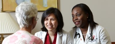 women cardiologists with patient