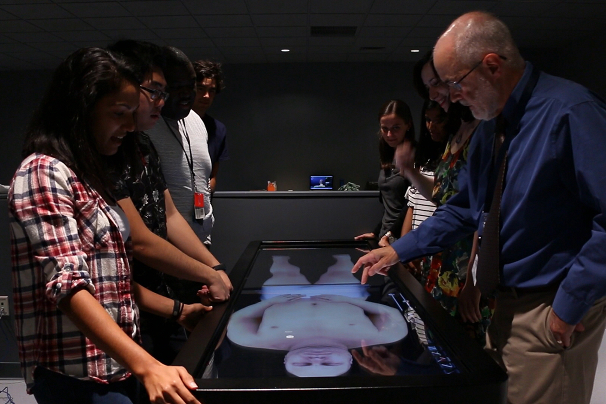 John Harrison, the director of the Human and Virtual Anatomy Lab at UConn Health, instructs medical and dental students on the use of the Anatomage table in the Virtual Anatomy Lab