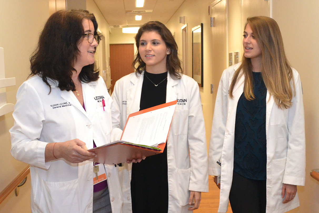 Medical students Martina Sinopoli and Anastasia Barros with Dr. Susan Levine