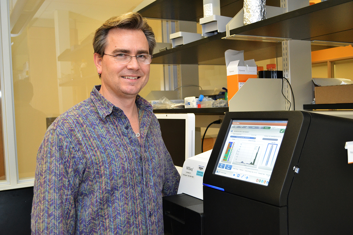 Brenton R. Graveley, Ph.D., in his lab